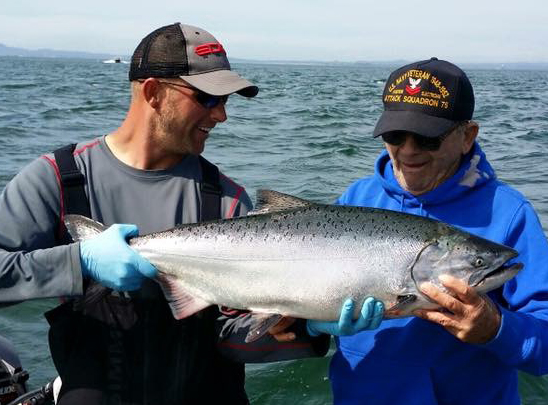 Admiring a beautiful catch by a Columbia River Guide customer | Willamette Valley Outfitters