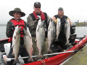 Clients Having a Successful Salmon Fishing Trip | Buoy 10 Fishing Guide