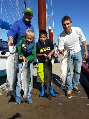 Family Catching Great Salmon in Oregon's Columbia River | Oregon Fishing Guide
